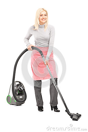 Full length portrait of a woman cleaner with hover