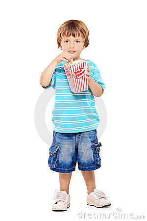 Full length portrait of young boy eating popcorn