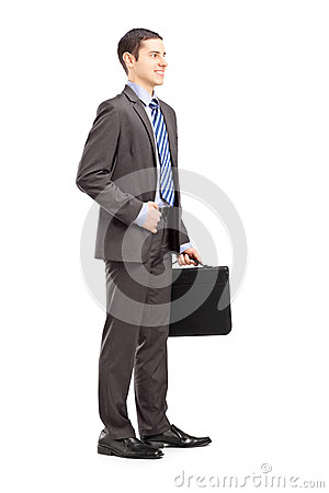 Full length portrait of a young businessman holding a briefcase