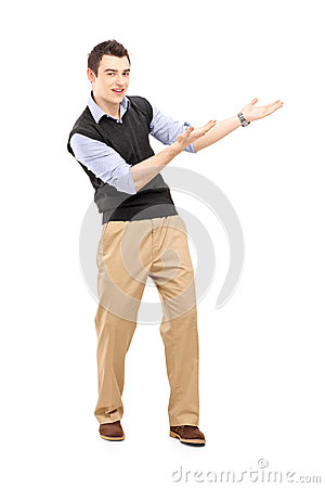 Full length portrait of a young cheerful man gesturing