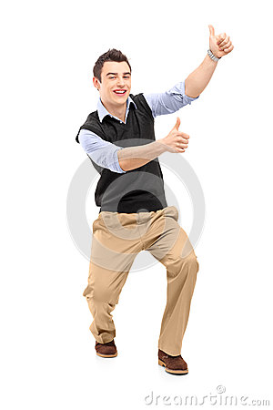 Full length portrait of a young cheerful man gesturing happiness