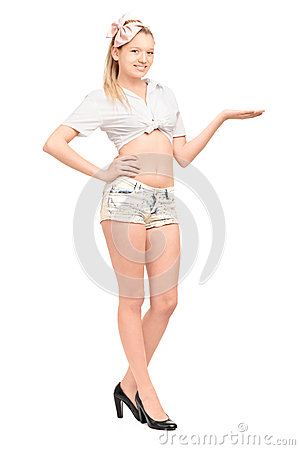 Full length portrait of a young female in short pants gesturing