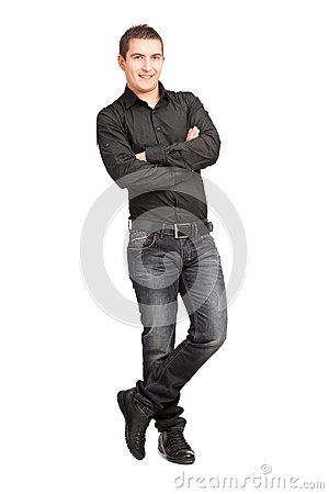 Full length portrait of a young male leaning against wall