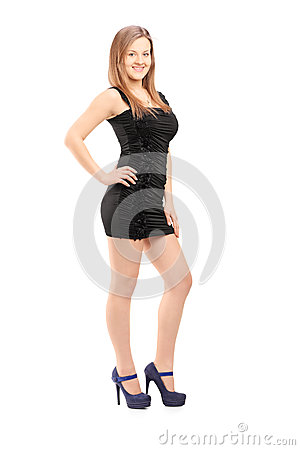 Full length portrait of a young smiling woman in a black dress l