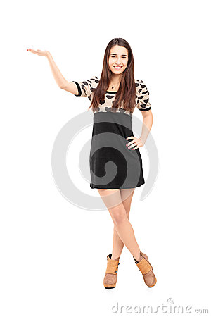 Full length portrait of a young woman gesturing with hand