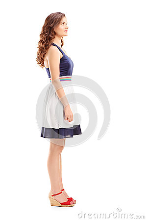 Full length portrait of a young woman in profile