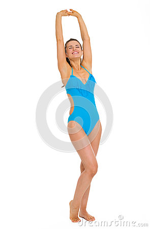 Full length portrait of young woman in swimsuit