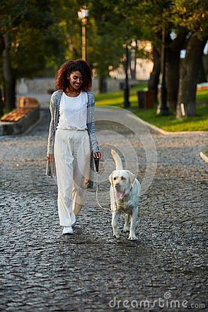Free Full-length Shot Of Pretty Healthy Young Lady Walking In The Morning In Park With Dog Stock Photography - 103076922
