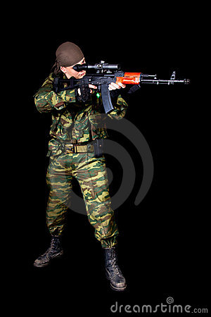Full length shot of soldier with weapon