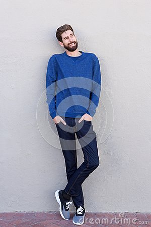 Free Full Length Smiling Confident Man Leaning On White Wall Royalty Free Stock Image - 92442286