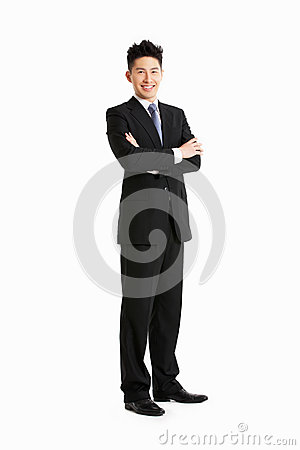 Full Length Studio Portrait Of Chinese Businessman