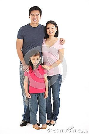 Full Length Studio Shot Of Chinese Family