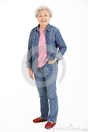 Full Length Studio Shot Of Chinese Senior Woman