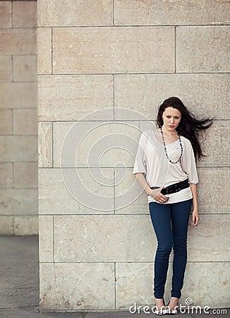 Full length stylish girl posing on street