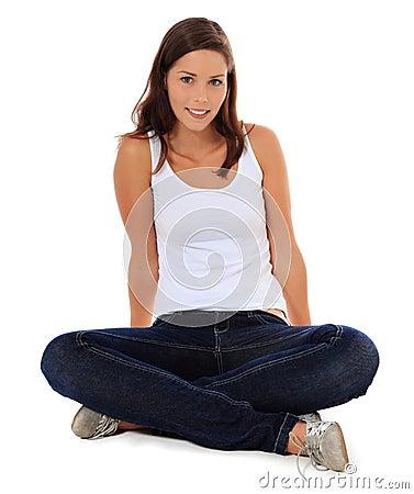 Full length teenage girl sitting on the floor