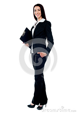 Full length of young businesswoman