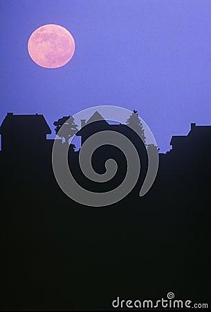 Full moon over family homes