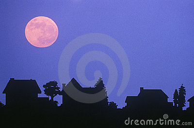 Full moon over family homes