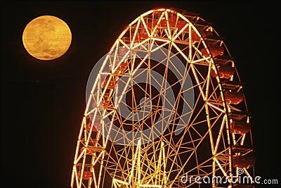 Full moon over Ferris Wheel