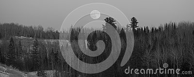 Full Moon Over Forested Hills