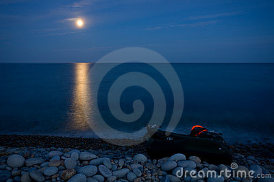 Full moon with reflection on sea