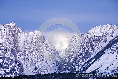 Full Moon Setting Behind The Grand Tetons,