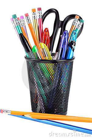 Black metal pencil cup filled with colorful pencils, pens and a pair ...