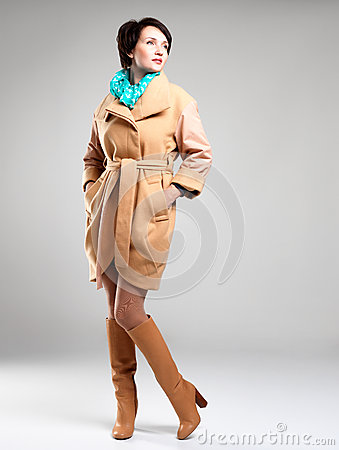 Full portrait of fashion woman in autumn coat with green scarf