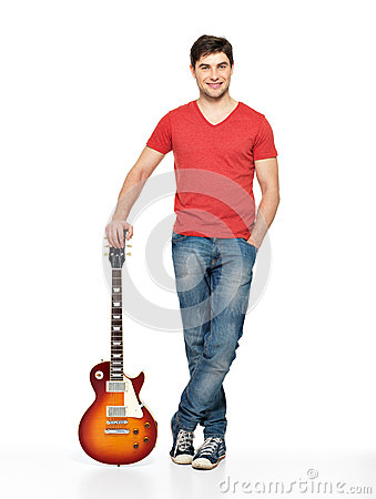 Full portrait of handsome man with   electric guitar
