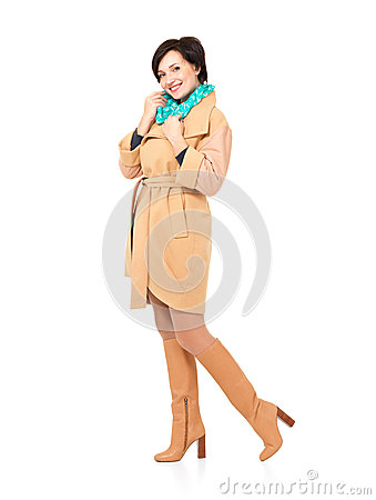 Full portrait of happy woman in fall coat with green scarf