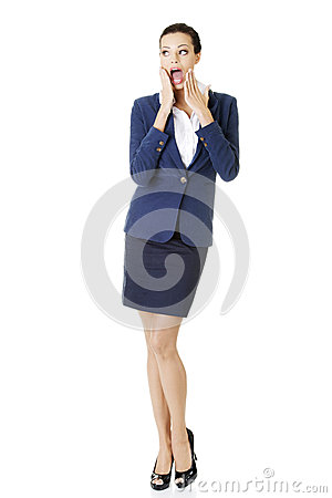 Full portrait of shocked businesswoman