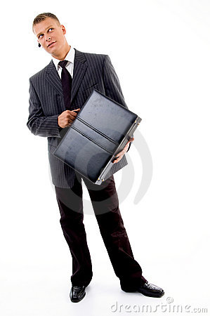 Full pose of young executive holding leather bag