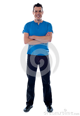 Full shot of a guy with crossed arms