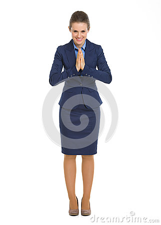 FullHappy business woman showing asian greeting
