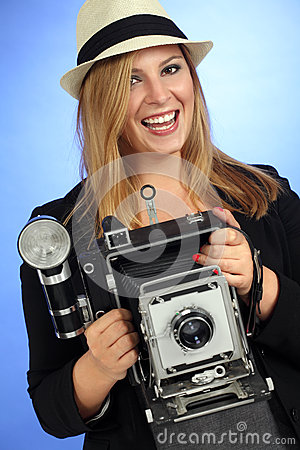 Fun Blond Female Holding Old Camera Stock Photography - Image: 25995552