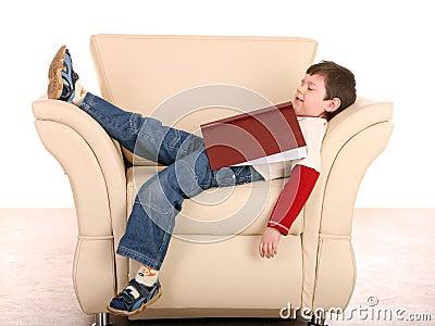 Fun boy sleep with book.