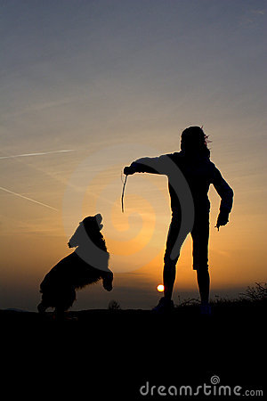 Fun of childen and dog in sunset