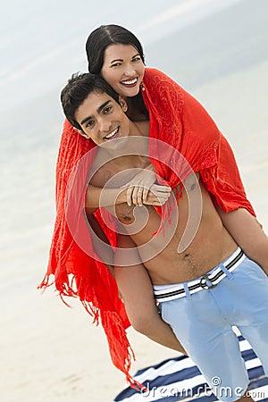 Fun couple at the beach