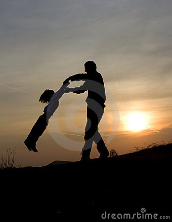 Fun of father and child in sunset