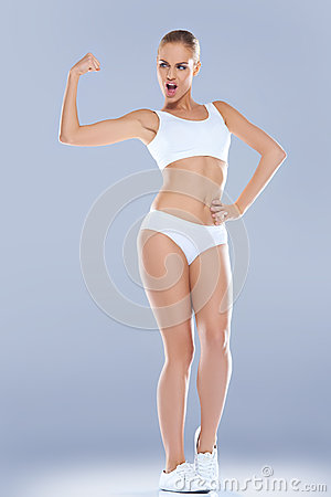 Fun image of a woman displaying her biceps