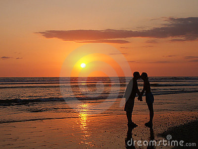 Fun kiss on the beach