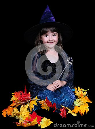 Fun little witch surrounded by golden leaves
