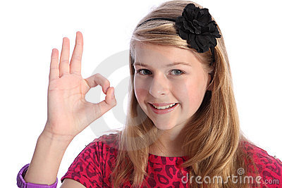 Fun positive okay hand sign by happy school girl
