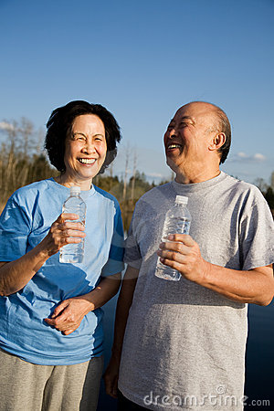 Fun senior asian couple