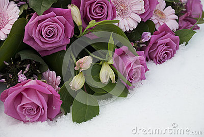 Funeral flowers in the snow on a cemetery