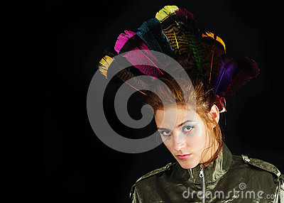 Funky girl portrait with feathers