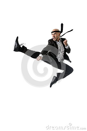 Free Funny Aggressive Businessman Wearing Suit Jumping On The Air In Kung Fu Kick Or Karate Flying Attack Royalty Free Stock Photo - 49192215