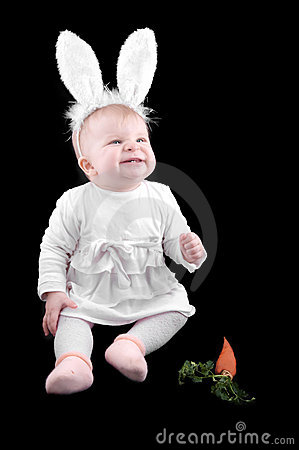 Funny baby in bunny costume and carrot