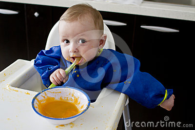 Funny baby eating diversification