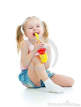 Child girl playing with musical toy